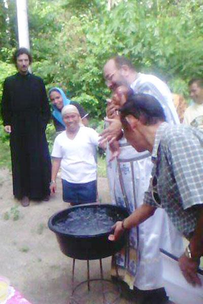 Baptizing baby Sarah