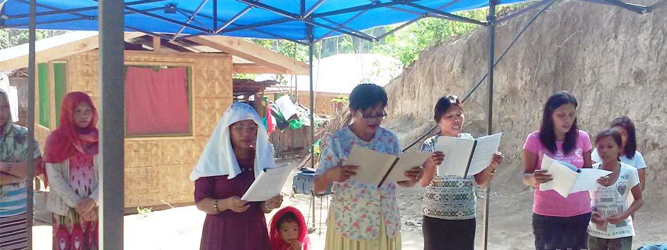 Liturgy under the tent at Kiblawan